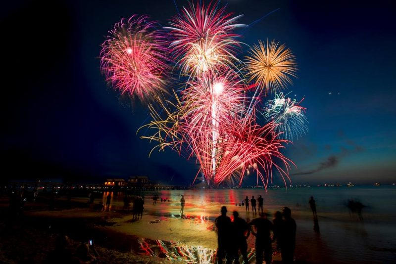 Fireworks going off over the beach at Fort Myers